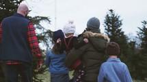 a family at a Christmas tree farm