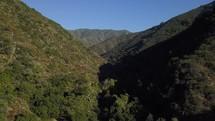 Bird's eye view of green hills in the desert.