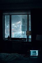 rainy scene at night out a window