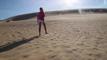 a girl walking in the desert
