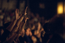 Audience with hands raised in worship.