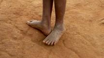 walking barefoot in Uganda