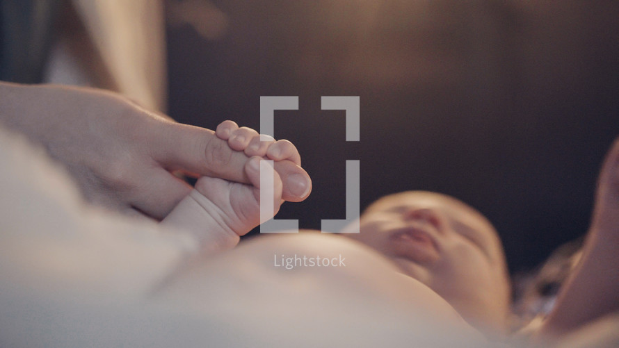 Baby Jesus holding Mary's finger