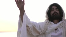 Jesus with raised hands