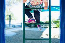 girl climbing on a playground