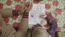 child coloring a child Christmas page