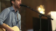 worship leader singing into a microphone