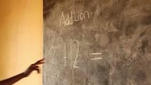 addition lesson in a school in Uganda