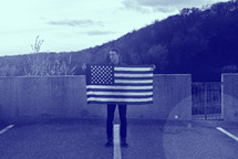 A man holding an American flag
