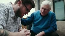 a senior man mentoring a young man