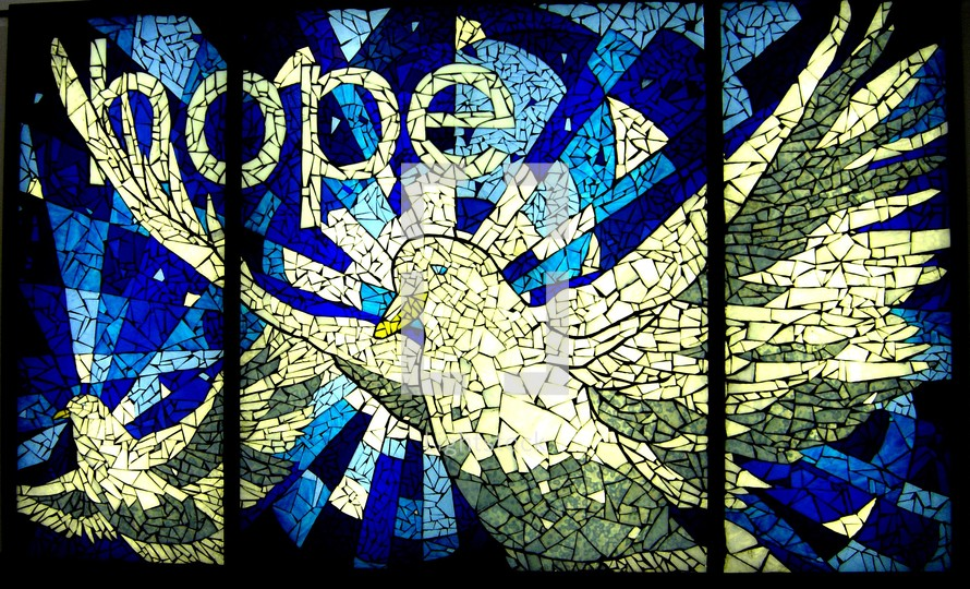 A stained glass art painting of the Holy Spirit descending as a dove with the words 'hope' representing the hope that is Christ to a lost world. A beautiful blue and white stained glass window with multiple polygons, tiles or cut glass depicting the Holy Spirit as a Dove.