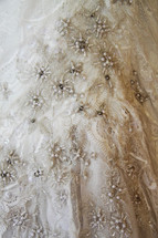 lace and beads on a wedding gown