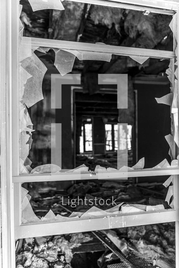 a broken window in an Abandoned house