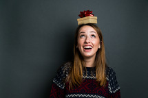 gifts on the head of a woman