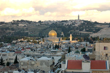 he Dome of the Rock and the Mount of Olives near sunset.