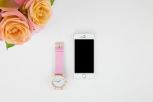 watch, iPhone, and roses in a vase