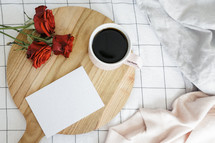 coffee mug, red roses, bed, sheets, wood board, red roses, sweater, breakfast in bed, envelope