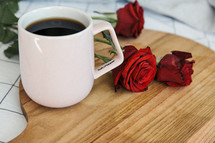 coffee mug, red roses, bed, sheets, wood board