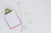 clipboard, blank paper, pencil, paper clips, pink, gold, polka dot