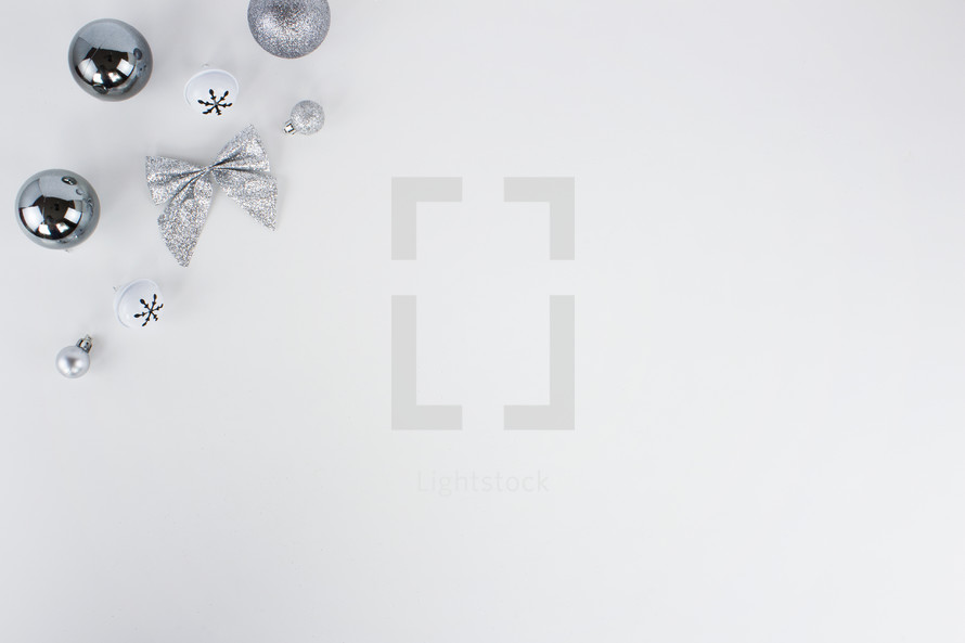 silver Christmas decorations on white