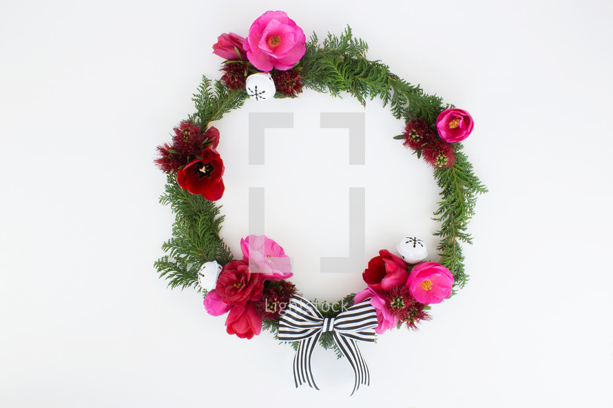 flowers and pine with bow on Christmas wreath