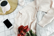 sweater, roses, sheets, linens, bed, bedding, bedspread, iphone, planner, journal, pencil, reading glasses, candle, coffee mug, grid