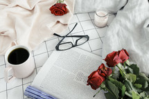 pages, book, reading in bed, sweater, roses, sheets, linens, bed, bedding, bedspread, planner, journal, pencil, reading glasses, candle, coffee mug, grid