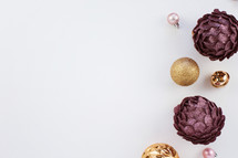 purple, pink, and gold Christmas ornaments on white