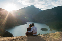 couple snuggling looking out at Diablo Lake