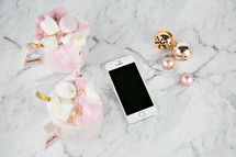 Christmas ornaments and iPhone on marble