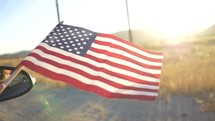 American Flag out of Car Window