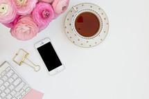 tea, computer keyboard, cellphone, pink peonies