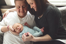 new parents holding their newborn