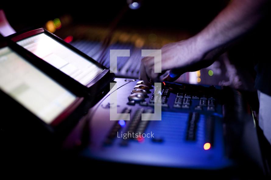 hand working controls on a soundboard