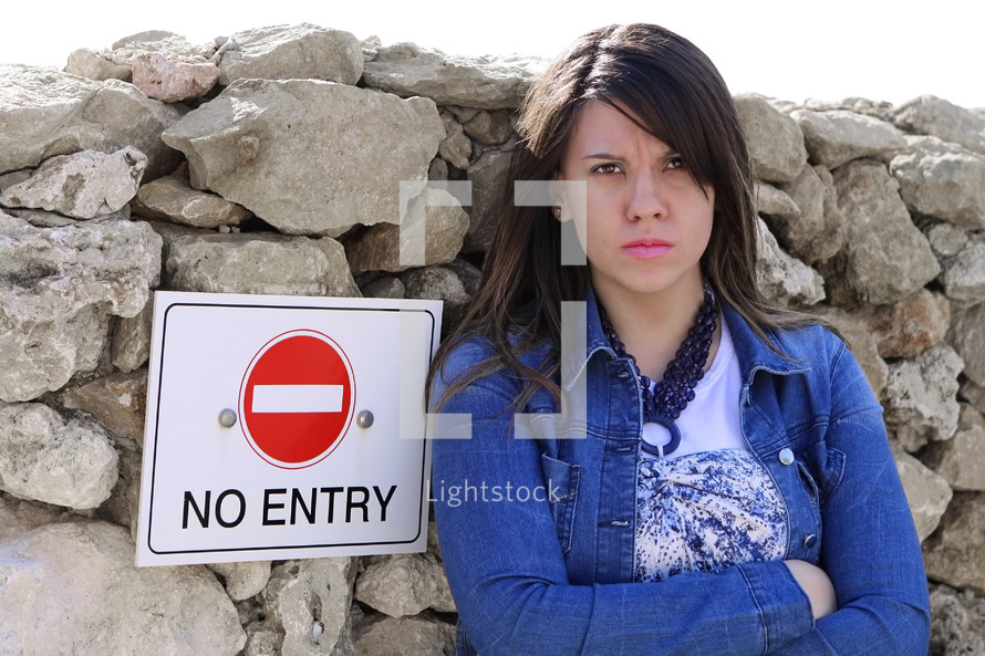 angry girl near a no entry sign