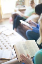 woman sitting reading Bibles at a Bible study