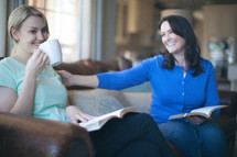 Smiling women drinking coffee during a Bible study.