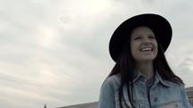 a smiling woman walking downtown