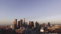 Aerial Sunrise of Downtown LA | Buildings | Track Shot | Pan Shot | Freeway | People | World | Evangelism | Urban | Hollywood | Early Morning | Day | Los Angeles | City of Angels | Ascending | Flying