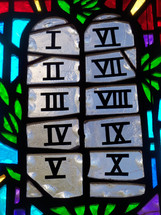 A stained glass window depicting the stone tables that make up the ten commandments given by God to Moses on Mount Sinai when the Israelites were wandering the desert in search of the promised land.