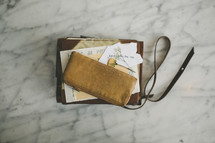 change purse, Bible, journal, dried flower, paper