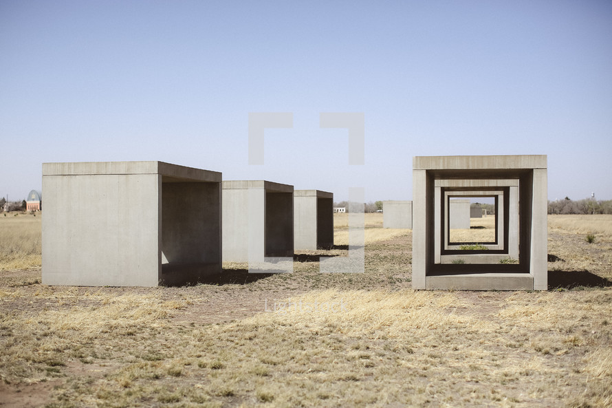 Rows of cement blocks in a field.