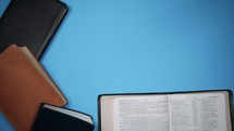 a circle of Bibles on a blue background