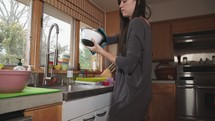 a woman putting away dishes