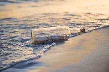 Message in a bottle washed up on shore.