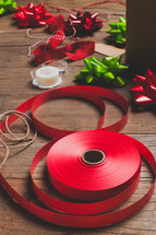 spool of red ribbon, ribbon, bows, ribbon, gift wrapped, tape, red, green