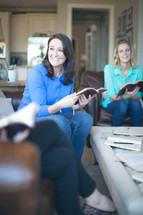 Smiling women at a bible study.