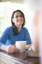 smiling woman at a Bible study