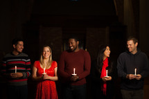 parishioners, congregation, worship service, standing, church, holding, candles, Christmas Eve, candlelight service, worship