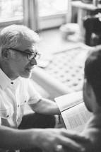Men sharing at a Bible study.